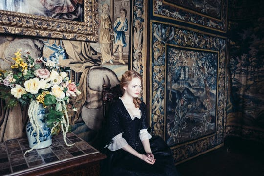 """Emma Stone is lost in the decor in """"The Favourite."""""""