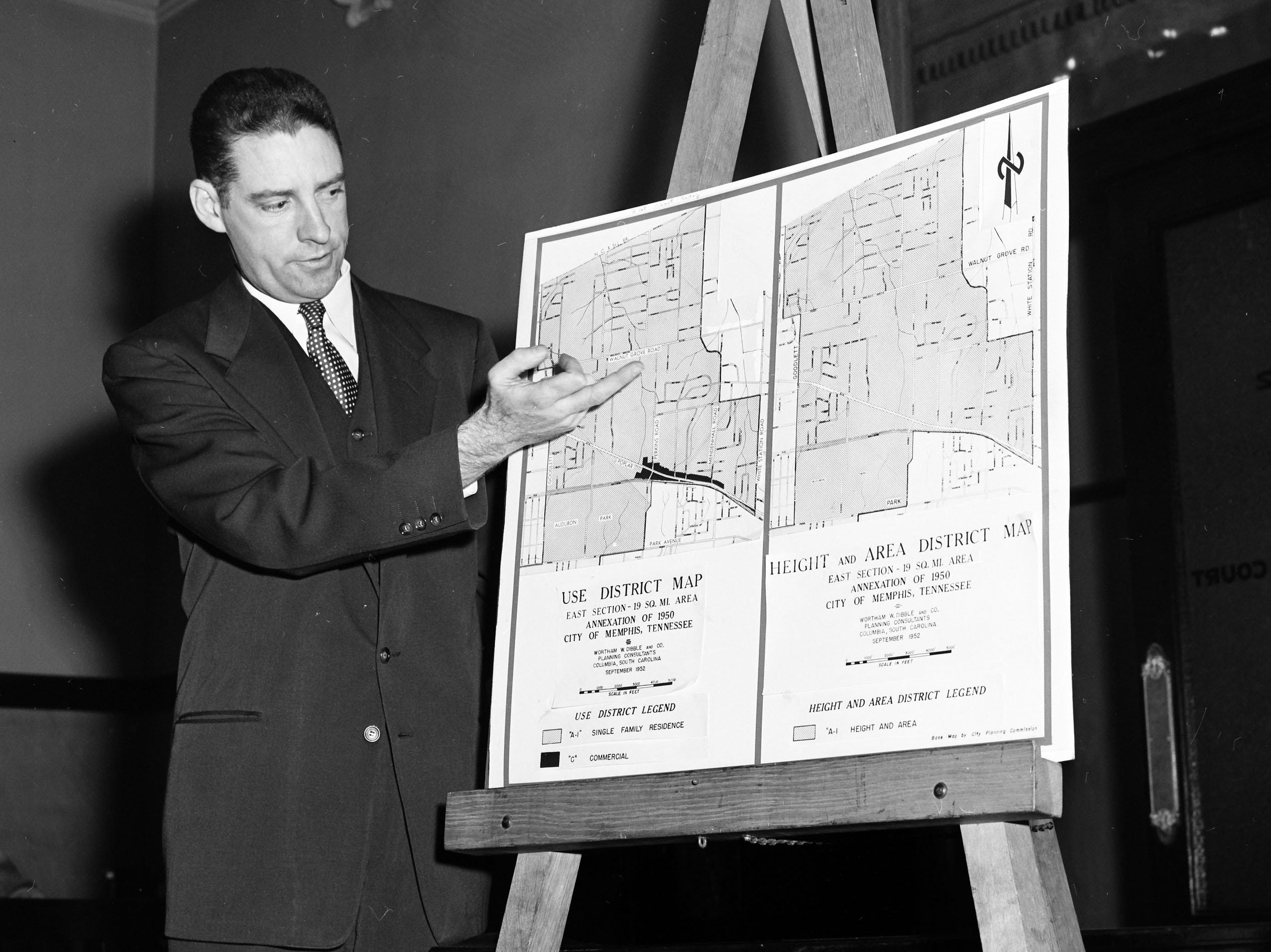 Memphis city planner Wortham W. Dibble answers questions on his new A-1 residential zoning recommendations in December 1952 for the three and a half square mile area of new East Memphis, north of Park and south of NC&StL Railroad.