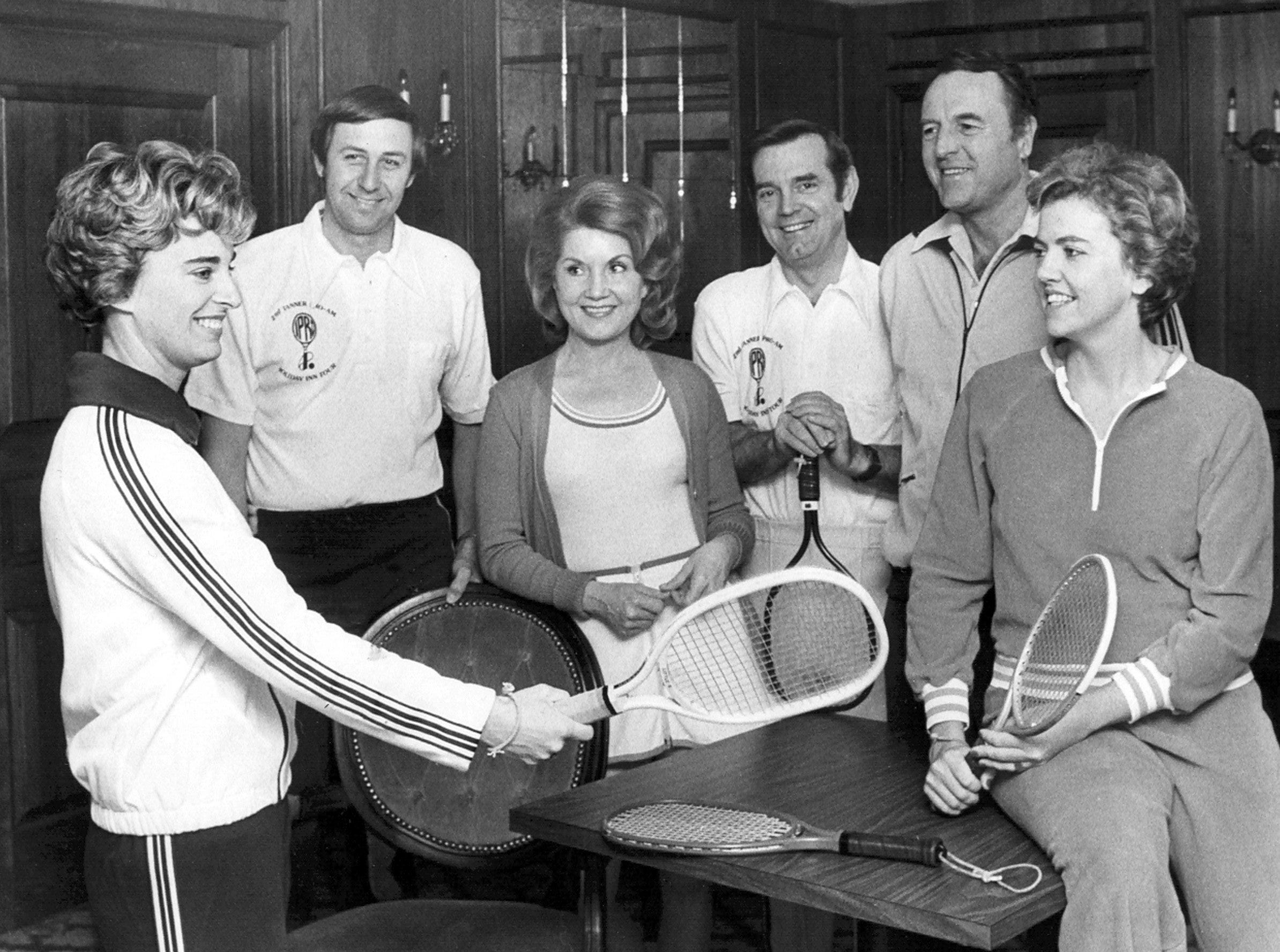 Mr. and Mrs. Don Kessinger (From Left), Mr. and Mrs. William B. Tanner and Mr. and Mrs. DeWitt Shy talk racquetball at the Racquet Club of Memphis on 6 Dec 1975.  They were attending a brunch and the topic of conversation was the upcoming William B. Tanner Pro-Am Racquetball championship.