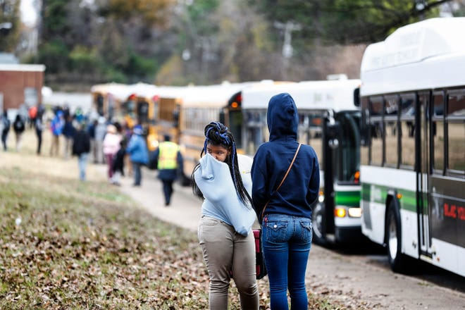 KIPP Collegiate High School and Academy Middle School students wait on school buses and MATA buses after a bomb threat was called into the school Tuesday morning. Memphis Police evacuated the building while searching the property.