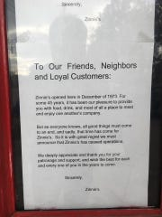 A notice taped to the door of Zinnie's confirms the beloved Midtown staple has closed its doors.