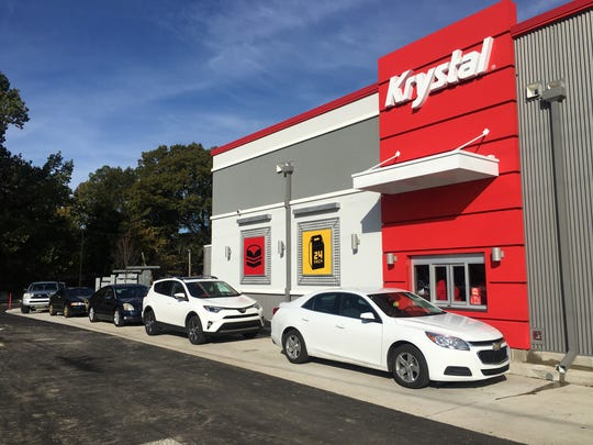 The new Krystal store on Elvis Presley Boulevard was built closer to the street to increase visibility and has two drive-thru lanes, reflecting a trend of fewer customers stopping to eat inside.