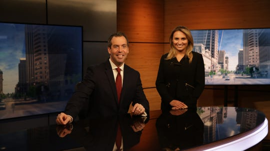 Jason Fechner, who anchors Spectrum News 1's 5 p.m. evening newscast, is joined on the set by meteorologist Brooke Brighton.