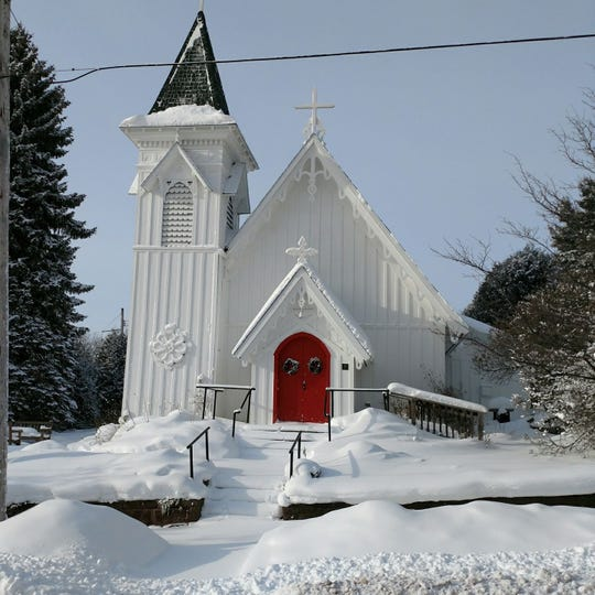 Historic Christ Episcopal Church in Bayfield paints its arched doors red, a tradition dating back to the Middle Ages.