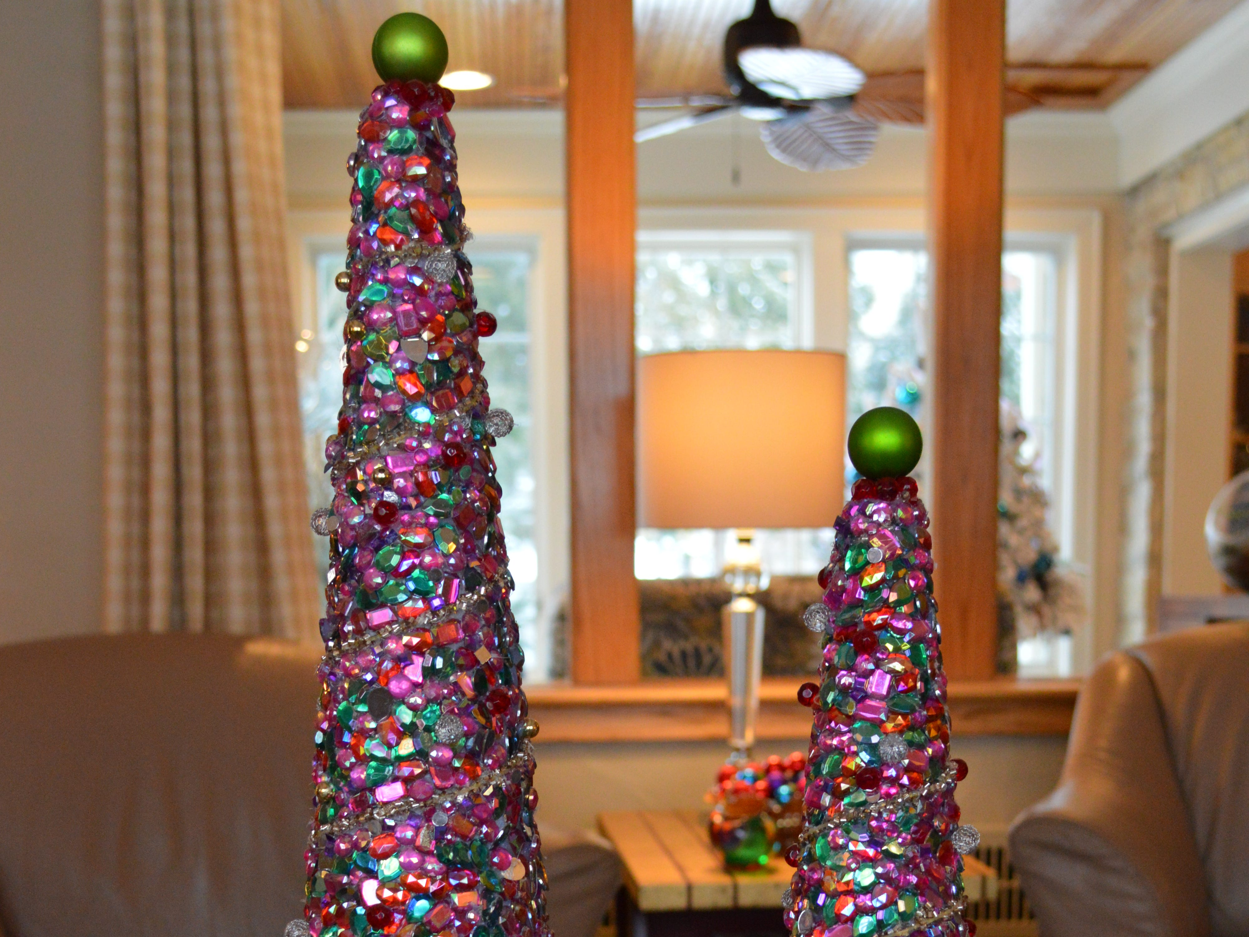Kathy Oelstrom, first vice president of the Wauwatosa Woman's Club, spent about 40 hours making these jeweled Christmas trees.