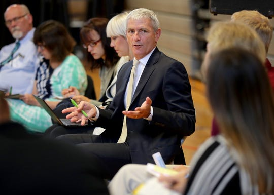 "Marquette University President Mike Lovell leads a breakout group during a July meeting of the SWIM ""Scaling Wellness in Milwaukee"" strategy meeting, meant to tackle the city's epidemic of neurological trauma."