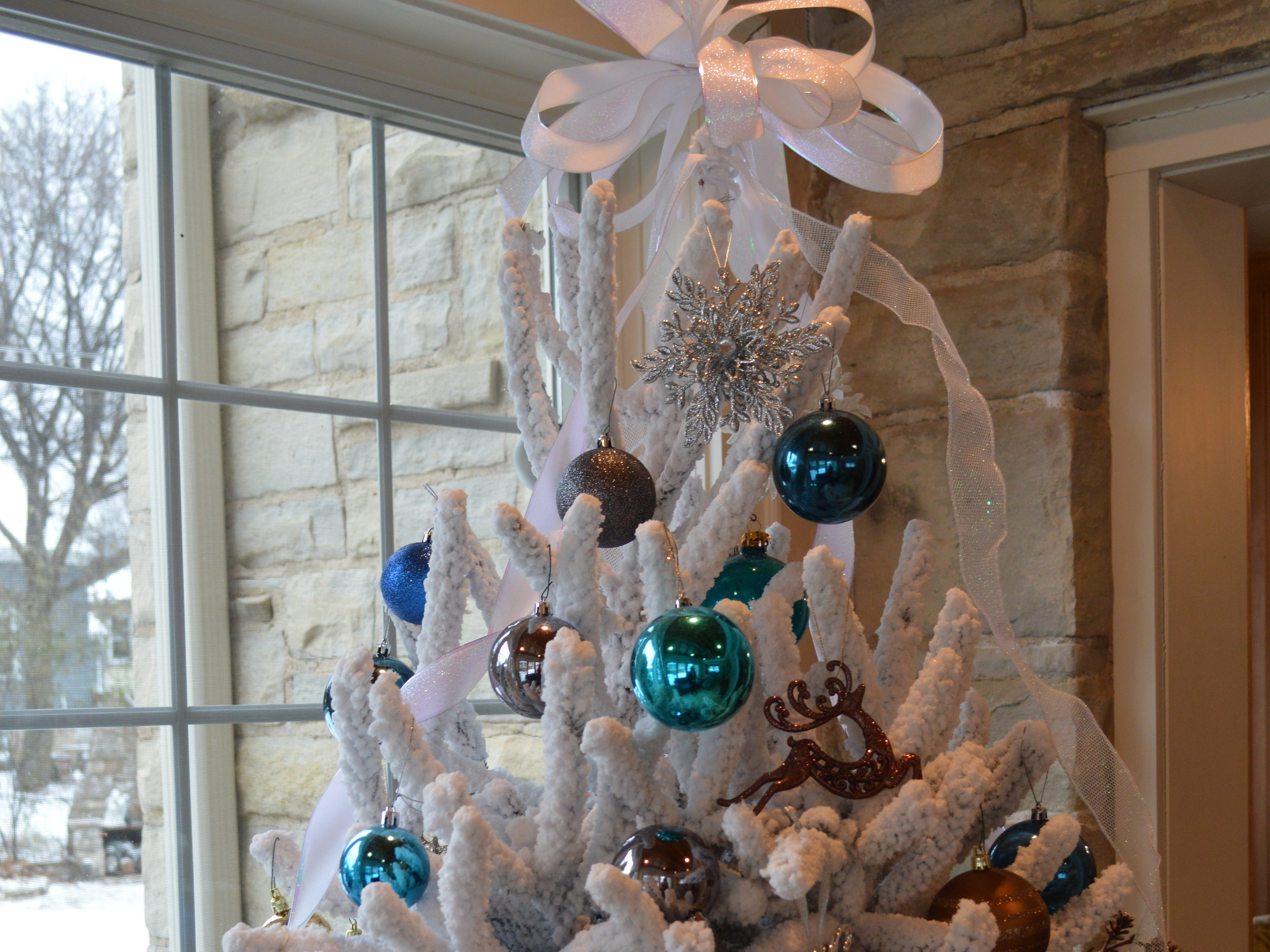 Kathy Oelstrom got a flocked Christmas tree in honor of her grandmother, who always had a blue one.