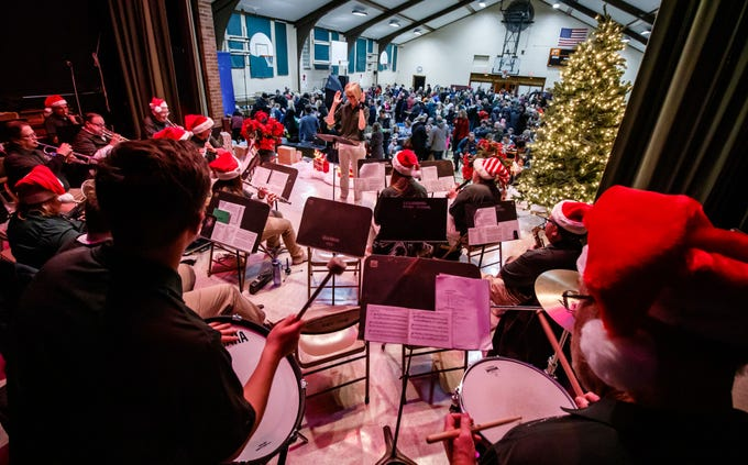 The Cedarburg Civic Band performs during Cedarburg's annual tree lighting ceremony at the Community Center on Monday, Nov. 26, 2018. The event, hosted by Cedarburg Chamber of Commerce, features make-and-take crafts, cookies, cider, music, caroling and a visit from Santa to light the tree.