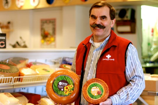 Owner Tony Zgraggen poses for a photo at the Alp and Dell artisanal cheese store in Monroe.