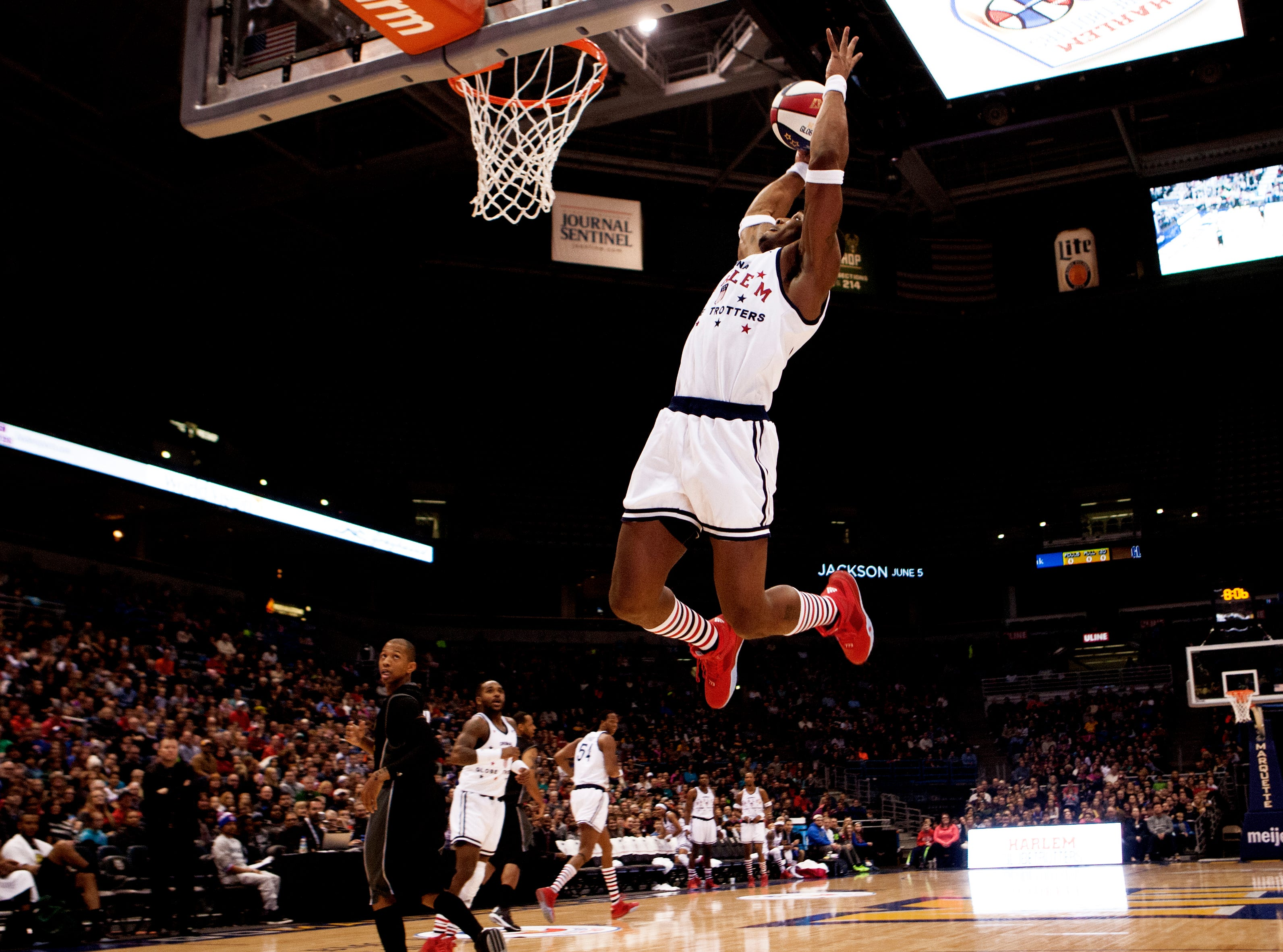 Harlem Globetrotters Thunder (34) dunks during a game at the BMO Harris Bradley Center in Milwaukee on Dec. 31, 2015.