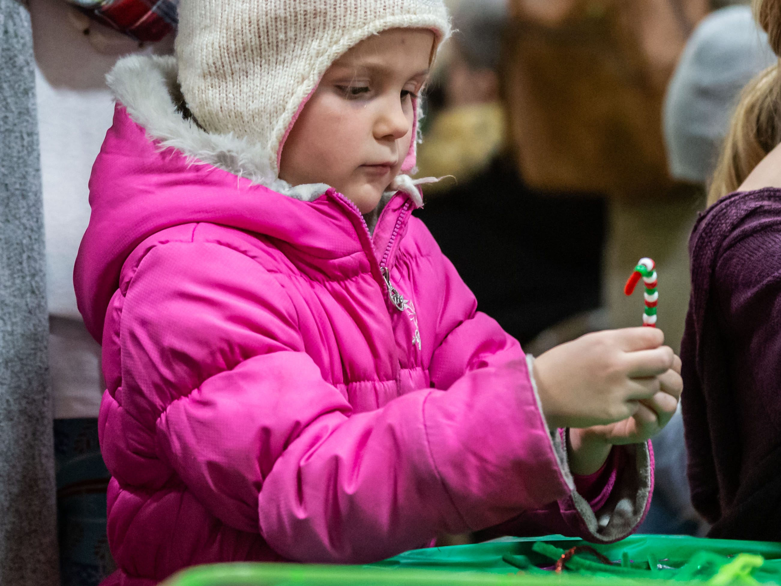 Taelyr Dainsberg, 6, of Grafton, makes an ornament during Cedarburg's annual tree lighting ceremony at the Community Center on Monday, Nov. 26, 2018. The event, hosted by Cedarburg Chamber of Commerce, features make-and-take crafts, cookies, cider, music, caroling and a visit from Santa to light the tree.