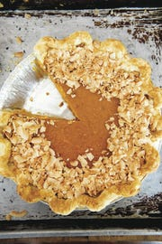"Large-flake coconut crowns the sweet potato-coconut pie in ""Sister Pie"" by Lisa Ludwinski."