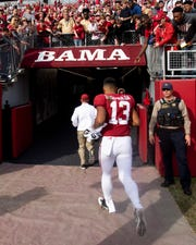 Alabama quarterback Tua Tagovailoa (13) leaves the field after defeating The Citadel at Bryant-Denny Stadium in Tuscaloosa, Ala., on Saturday November 17, 2018.