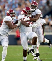 Alabama defensive lineman Raekwon Davis (99), defensive lineman Phidarian Mathis (48) and defensive lineman Isaiah Buggs (49) celebrate a Mathis fumble recovery against Ole Miss in first half action in Oxford, Ms., on Saturday September 15, 2018.