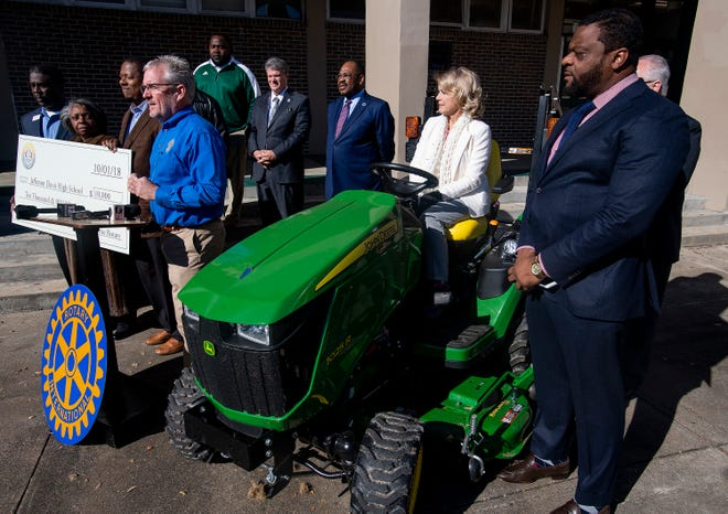 Glenn Crumpton, of the Montgomery Sunrise Rotary Club, along with County Commissioners presents a tractor to the Jeff Davis High School athletic department at the school in Montgomery, Ala., on Tuesday November 27, 2018.