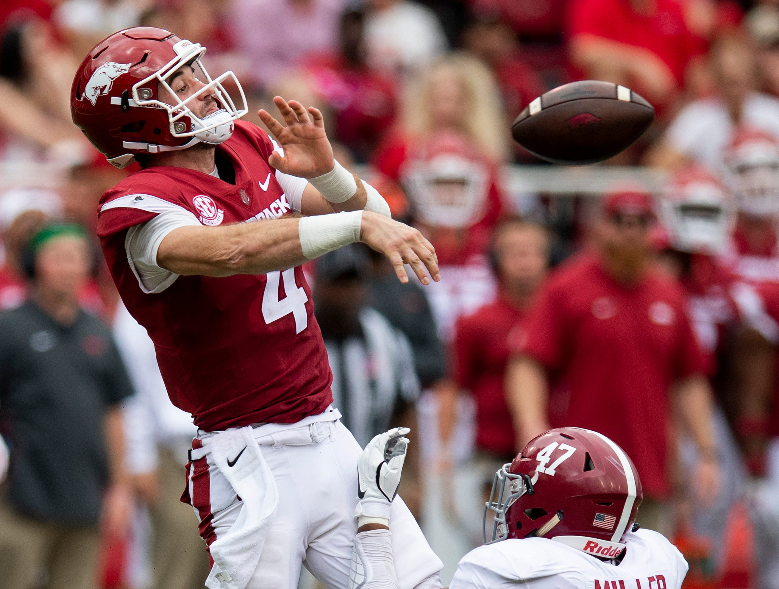 Arkansas quarterback Ty Storey (4)  throws an incomplete pass as Alabama linebacker Christian Miller (47) tackles him during first half action in Fayetteville, Ark., on Saturday October 6, 2018.