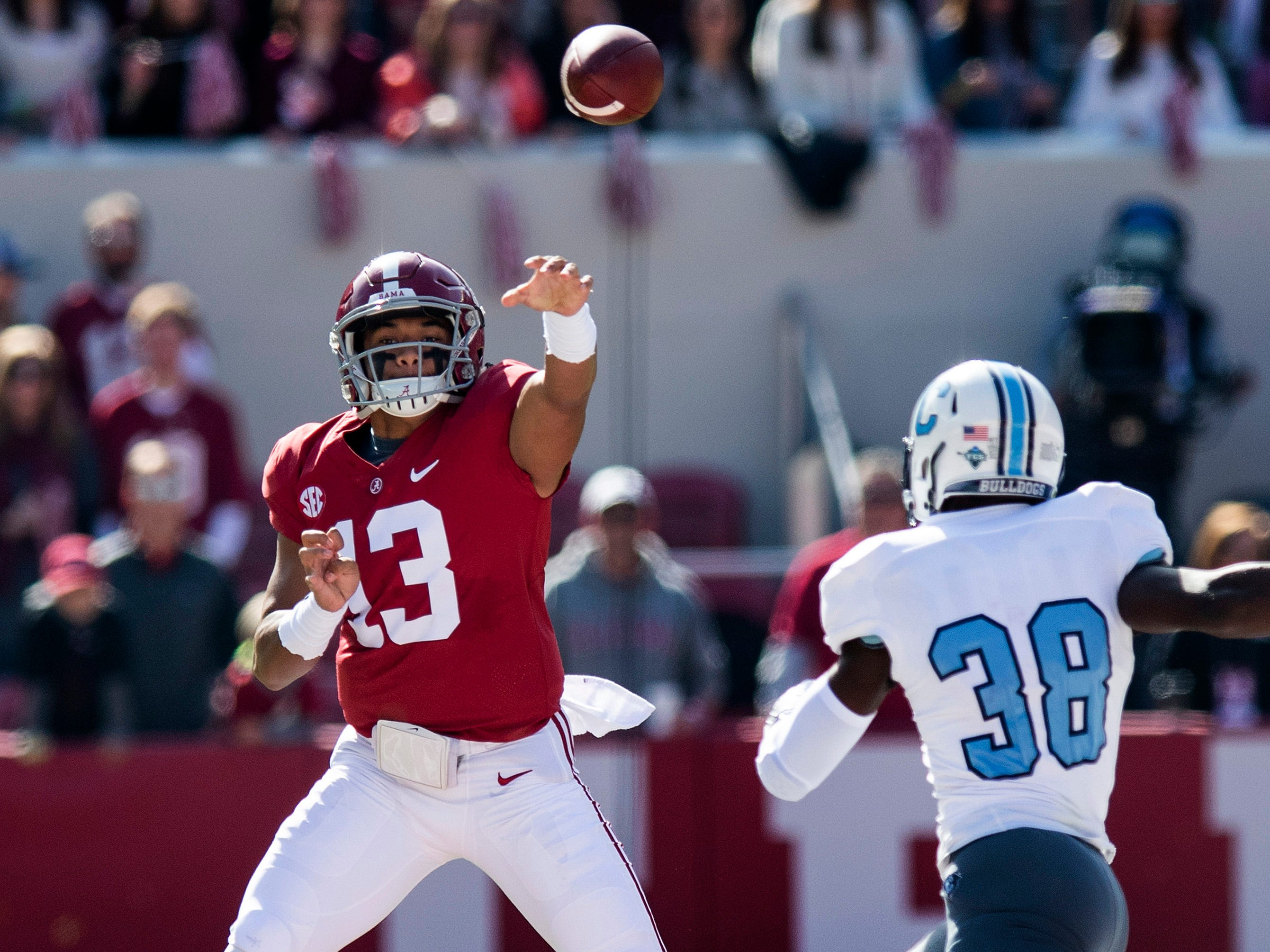 Alabama quarterback Tua Tagovailoa (13) passes over Citadel linebacker Noah Dawkins (38) In first half action at Bryant-Denny Stadium in Tuscaloosa, Ala., on Saturday November 17, 2018.