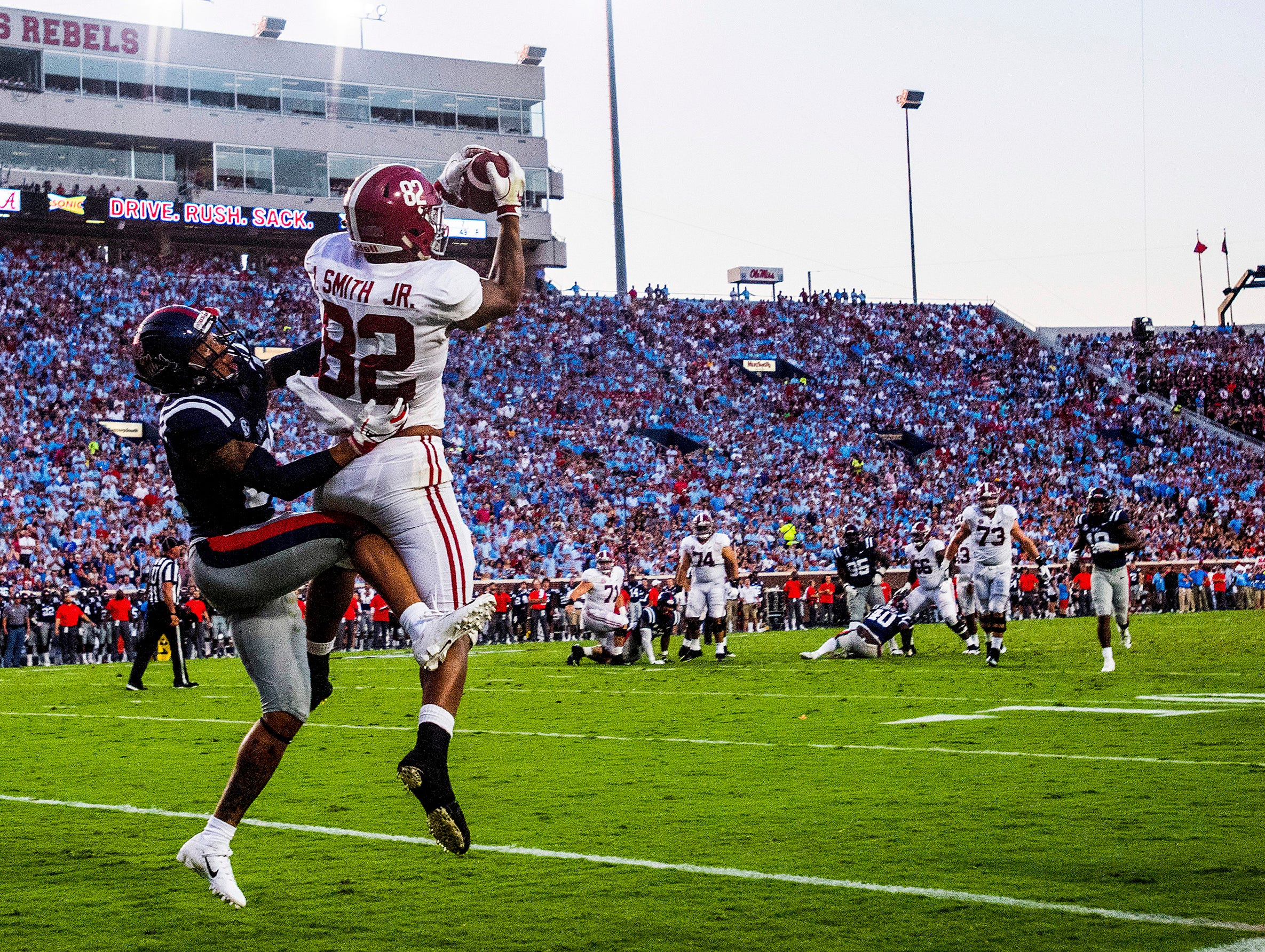 Alabama tight end Irv Smith Jr. (82) catches a touchdown pass against Ole Miss defensive back Javien Hamilton (21) In first half action in Oxford, Ms., on Saturday September 15, 2018.