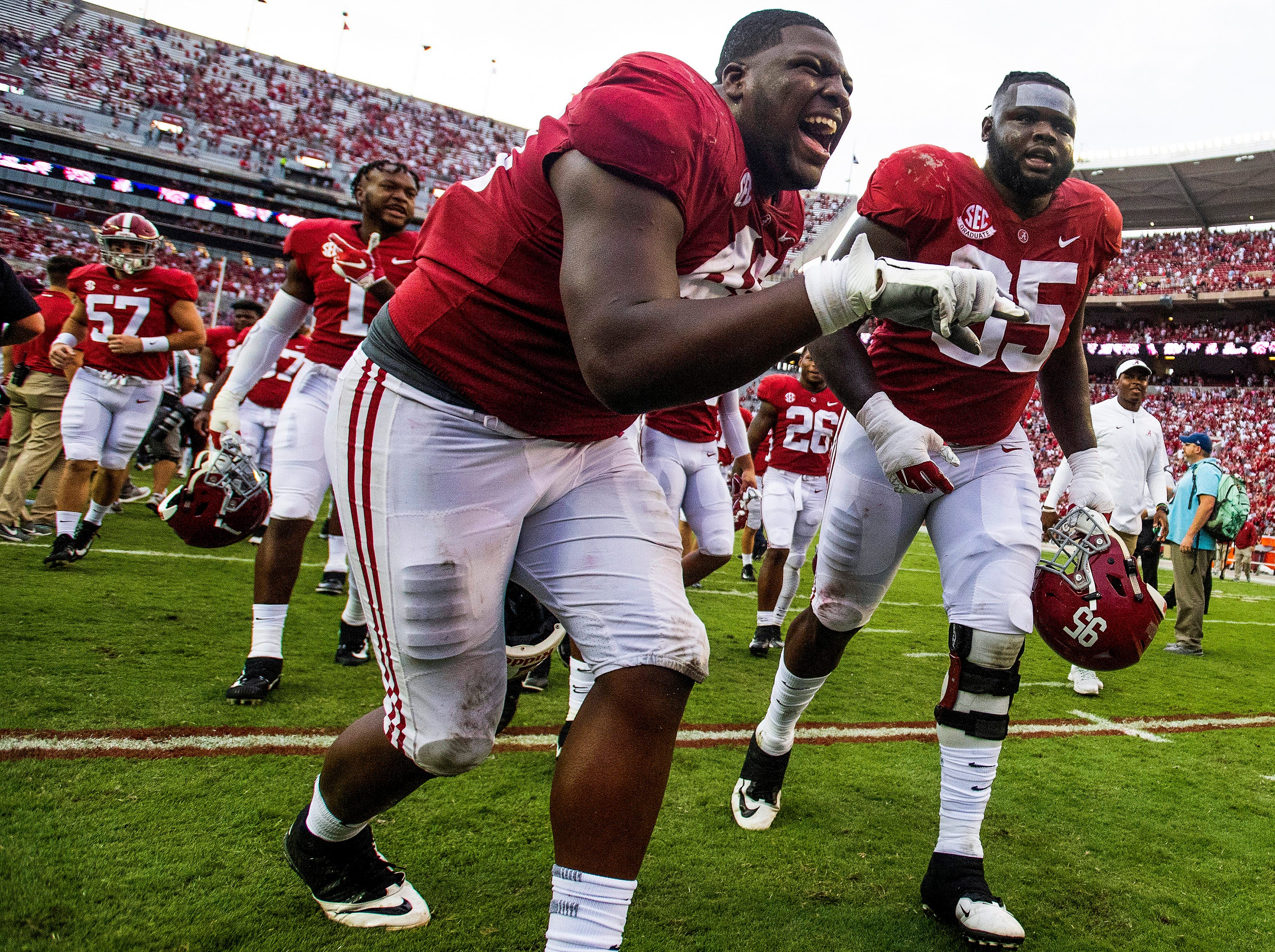 Alabama defensive linemen Phidarian Mathis (48) and Johnny Dwight (95) celebrate Dwight's sack to end the game in Tuscaloosa, Ala., on Saturday September 22, 2018.