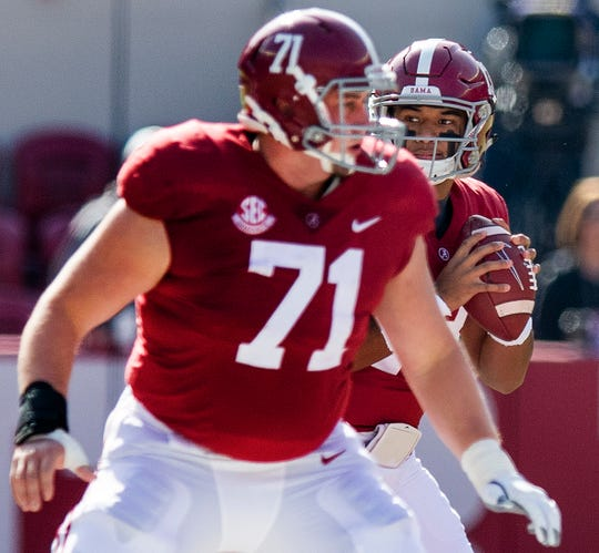Alabama quarterback Tua Tagovailoa (13) looks to pass from behind offensive lineman Ross Pierschbacher (71) In first half action at Bryant-Denny Stadium in Tuscaloosa, Ala., on Saturday November 17, 2018.