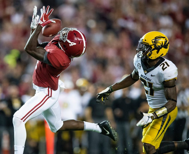 Alabama wide receiver Jerry Jeudy (4) catches a pass from quarterback Jalen Hurts (2) in second half action against Missouri defensive back Christian Holmes (21) at Bryant Denny Stadium in Tuscaloosa, Ala., on Saturday October 13, 2018.