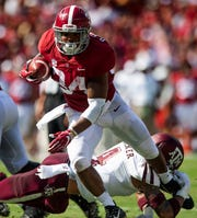 Alabama running back Damien Harris (34) runs against Texas A&M In first half action in Tuscaloosa, Ala., on Saturday September 22, 2018.