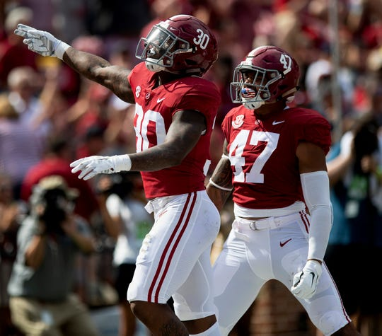 Alabama linebackers Mack Wilson (30) and Christian Miller (47) celebrate Wilson's interception against Texas A&M In first half action in Tuscaloosa, Ala., on Saturday September 22, 2018.