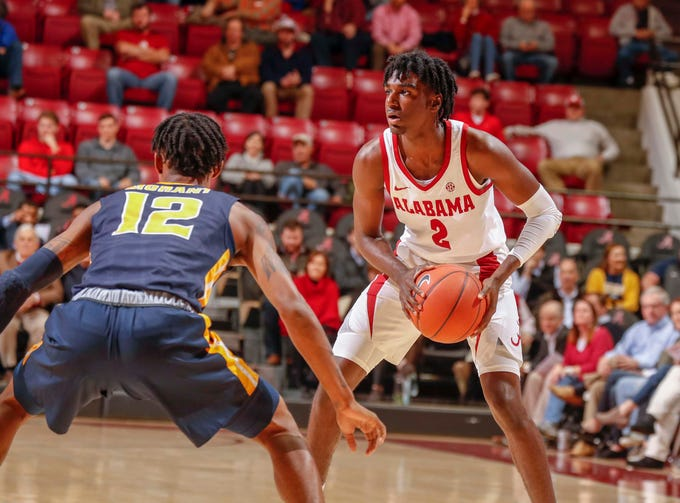 Alabama freshman guard Kira Lewis Jr. (2) looks to pass while being defended by Murray State's Ja Morant (12) during their game Monday night, Nov. 26, 2018 inside Coleman Coliseum in Tuscaloosa, Ala. (Photo by Robert Sutton/Alabama athletics)