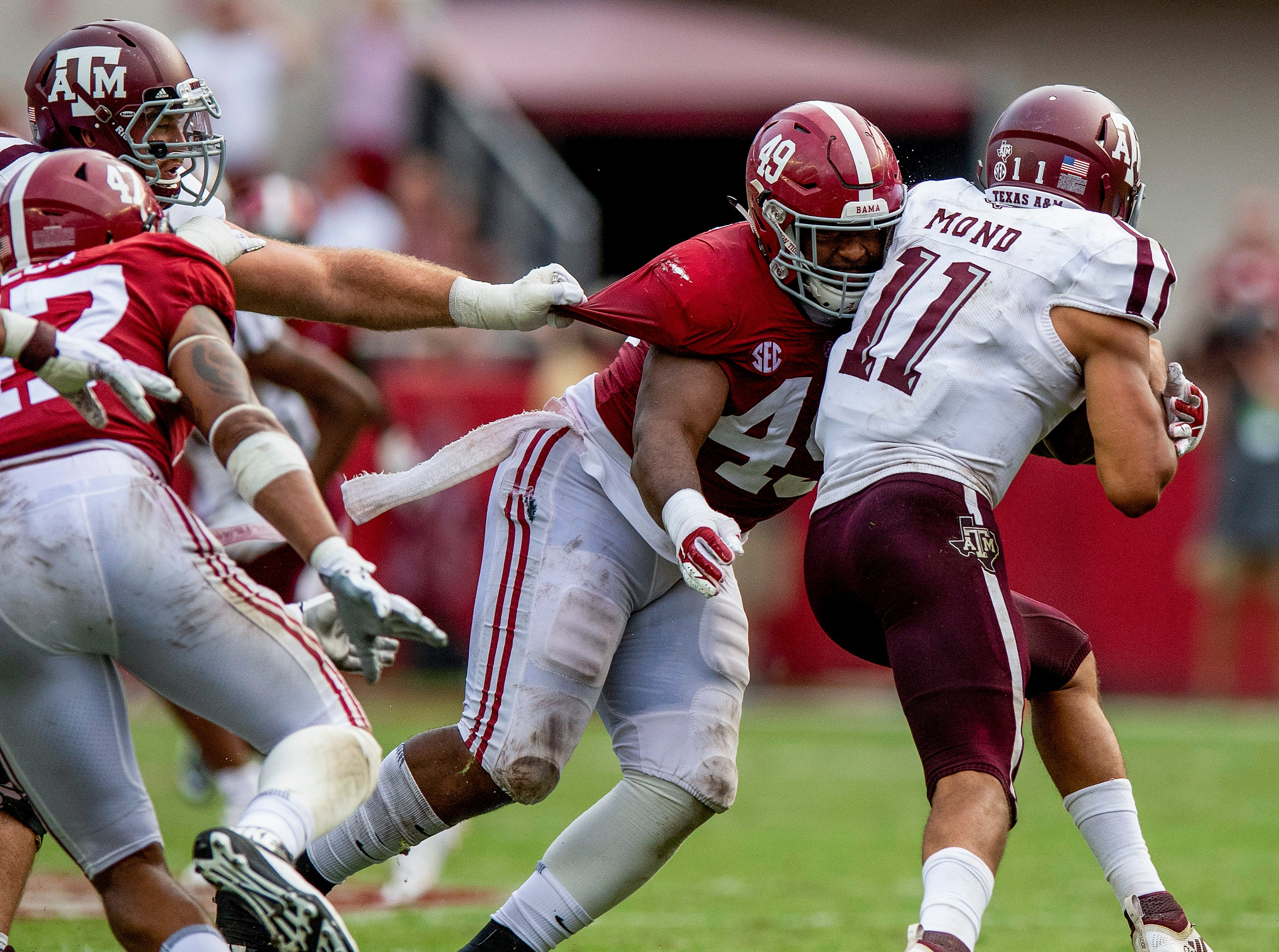 Alabama defensive lineman Isaiah Buggs (49) sacks Texas A&M quarterback Kellen Mond (11) in second half action in Tuscaloosa, Ala., on Saturday September 22, 2018.