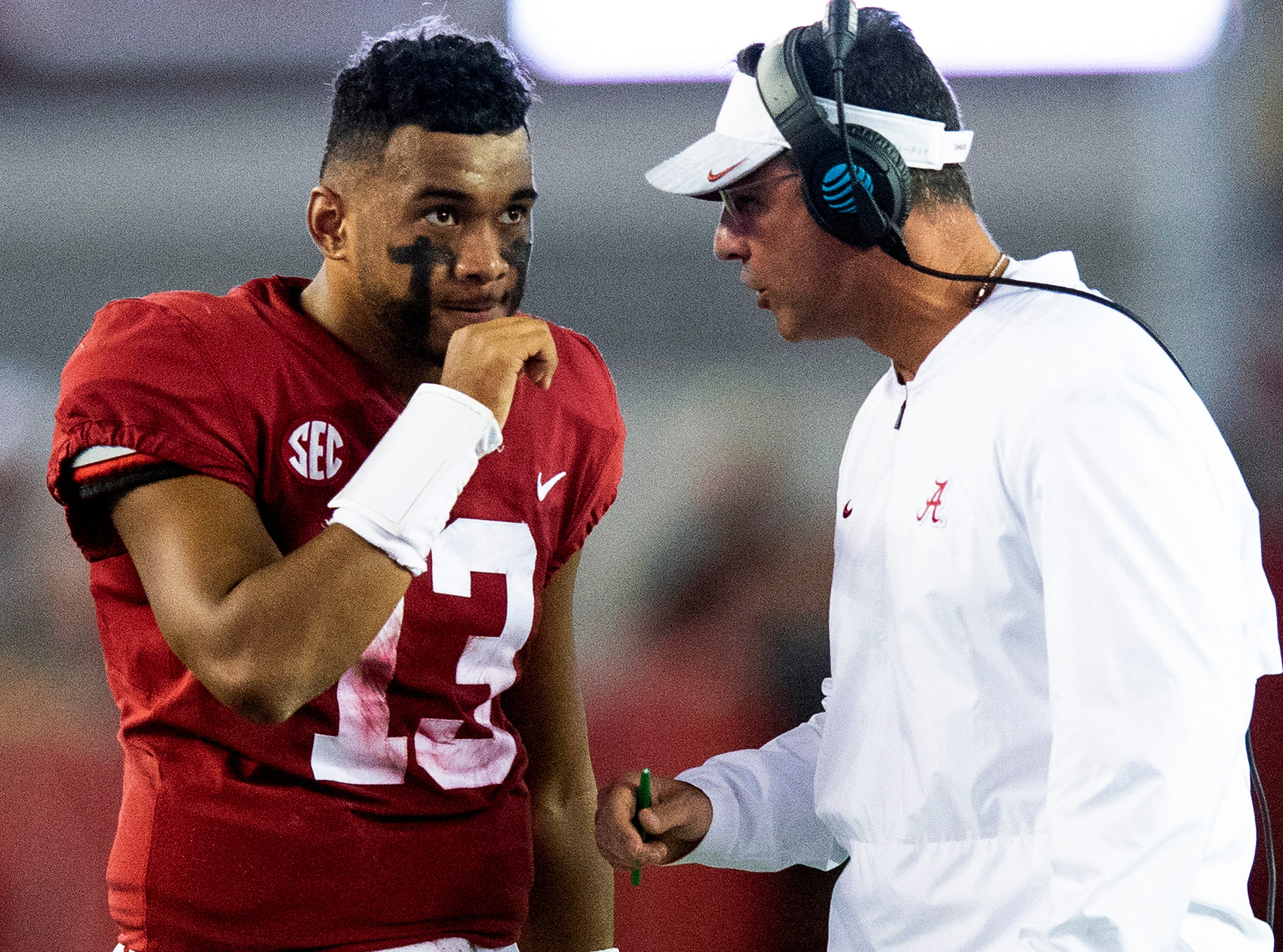 Alabama quarterback Tua Tagovailoa (13) talks with quarterbacks coach Dan Enos in first half action against Missouri at Bryant Denny Stadium in Tuscaloosa, Ala., on Saturday October 13, 2018.