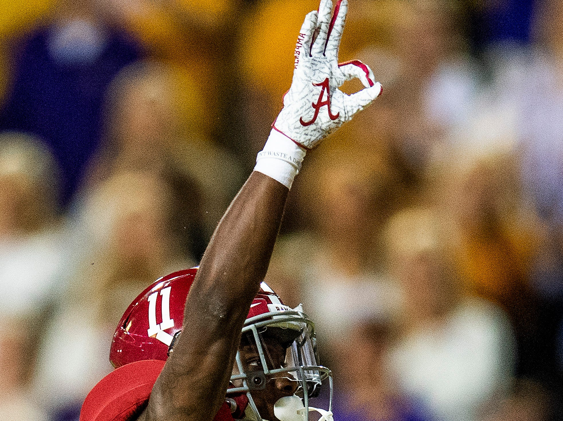 Alabama wide receiver Henry Ruggs, III, (11) celebrates his touchdown against Louisiana State University in first half action at Tiger Stadium in Baton Rouge, La., on Saturday November 3, 2018.