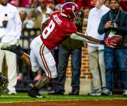 Alabama running back Josh Jacobs (8) scores a touchdown against Auburn in second half action during the Iron Bowl at Bryant-Denny Stadium in Tuscaloosa, Ala., on Saturday November 24, 2018.