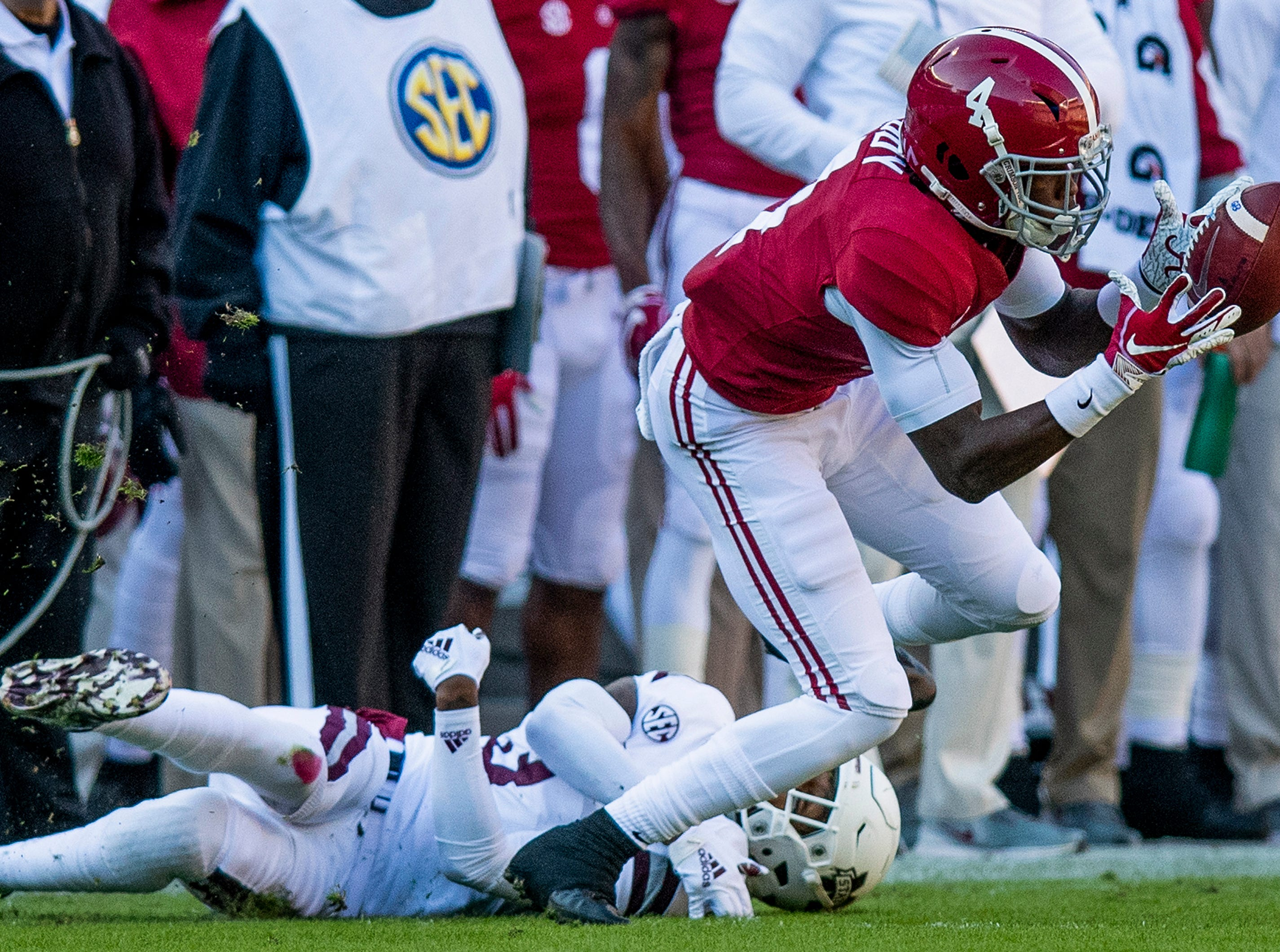 Alabama wide receiver Jerry Jeudy (4) catches a pass against Mississippi State University in first half action at Bryant Denny Stadium in Tuscaloosa, Ala., on Saturday November 9, 2018.