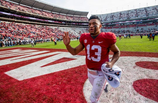 Alabama quarterback Tua Tagovailoa (13) runs off the field after defeating The Citadel in second half action at Bryant-Denny Stadium in Tuscaloosa, Ala., on Saturday November 17, 2018.
