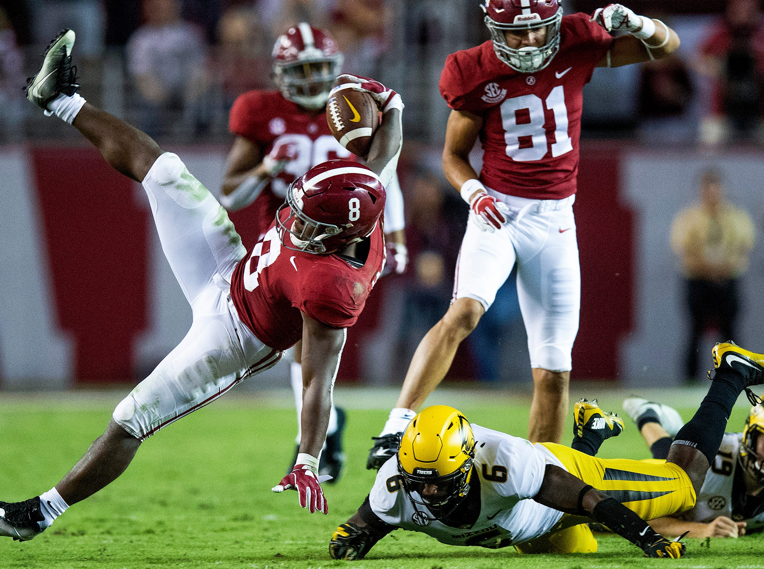 Alabama running back Josh Jacobs (8) is upended by Missouri linebacker Tavon Ross (6) in second half action at Bryant Denny Stadium in Tuscaloosa, Ala., on Saturday October 13, 2018.