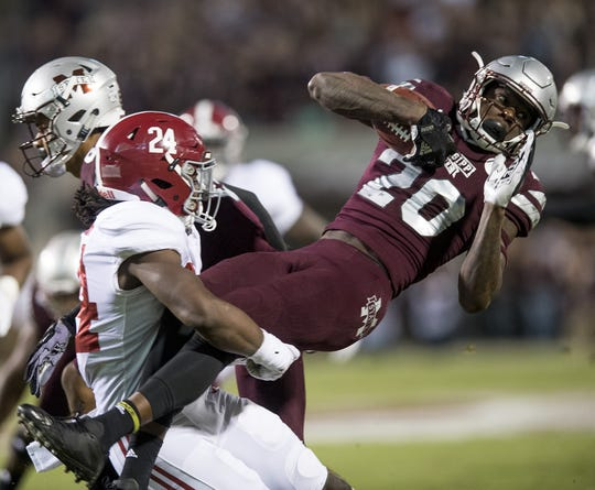 Alabama linebacker Terrell Lewis (24) stops Mississippi State wide receiver Reggie Todd (20) on a kick return in first half action in Starkville, Ms. on Saturday November 11, 2017. (Mickey Welsh / Montgomery Advertiser)