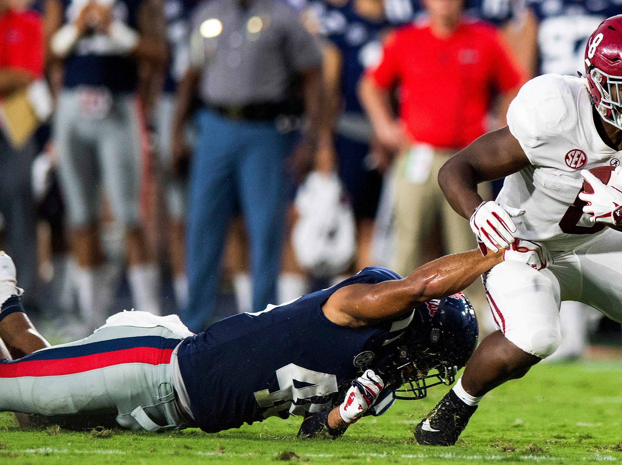 Alabama running back Josh Jacobs (8) eludes the tackle of Ole Miss linebacker Andrew Griffith (48) In first half action in Oxford, Ms., on Saturday September 15, 2018.