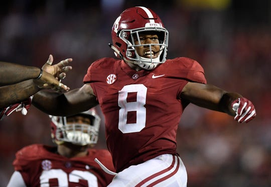 Alabama running back Josh Jacobs (8) celebrates sporting a touchdown against Louisville In second half action of the Camping World Kickoff at Camping World Stadium in Orlando, Fla., on Saturday September 1, 2018.
