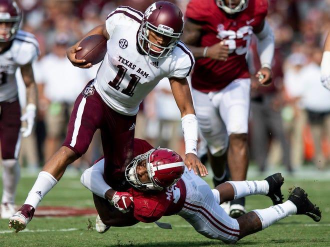 Alabama defensive back Xavier McKinney (15) stops Texas A&M quarterback Kellen Mond (11) In first half action in Tuscaloosa, Ala., on Saturday September 22, 2018.