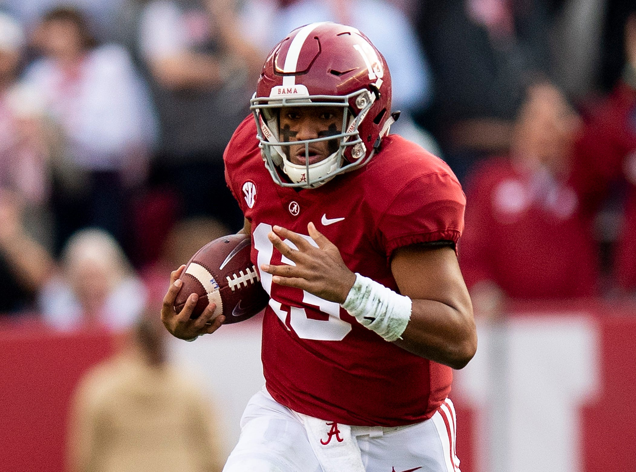 Alabama quarterback Tua Tagovailoa (13) carries the ball in first half action against Auburn during the Iron Bowl at Bryant-Denny Stadium in Tuscaloosa, Ala., on Saturday November 24, 2018.