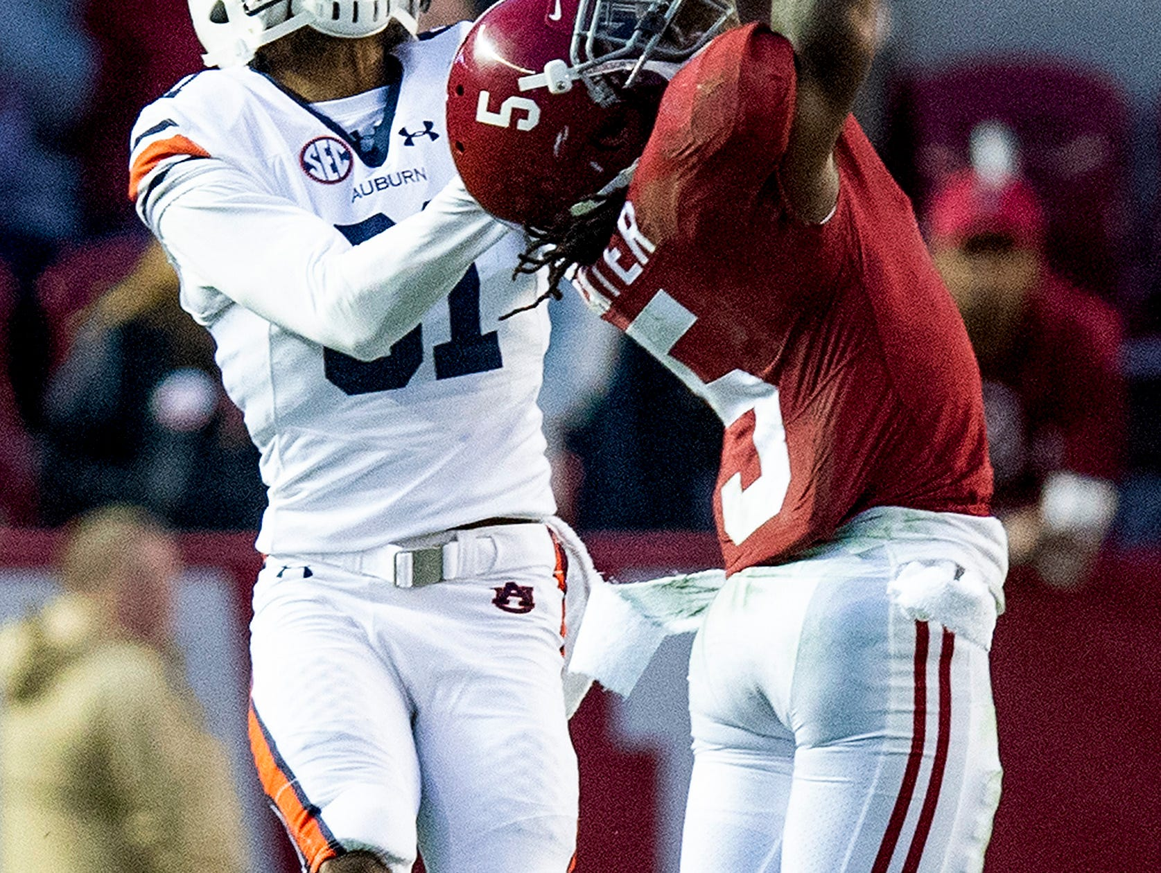 Alabama defensive back Shyheim Carter (5) breaks up a pass intended for Auburn wide receiver Darius Slayton (81) in second half action during the Iron Bowl at Bryant-Denny Stadium in Tuscaloosa, Ala., on Saturday November 24, 2018.