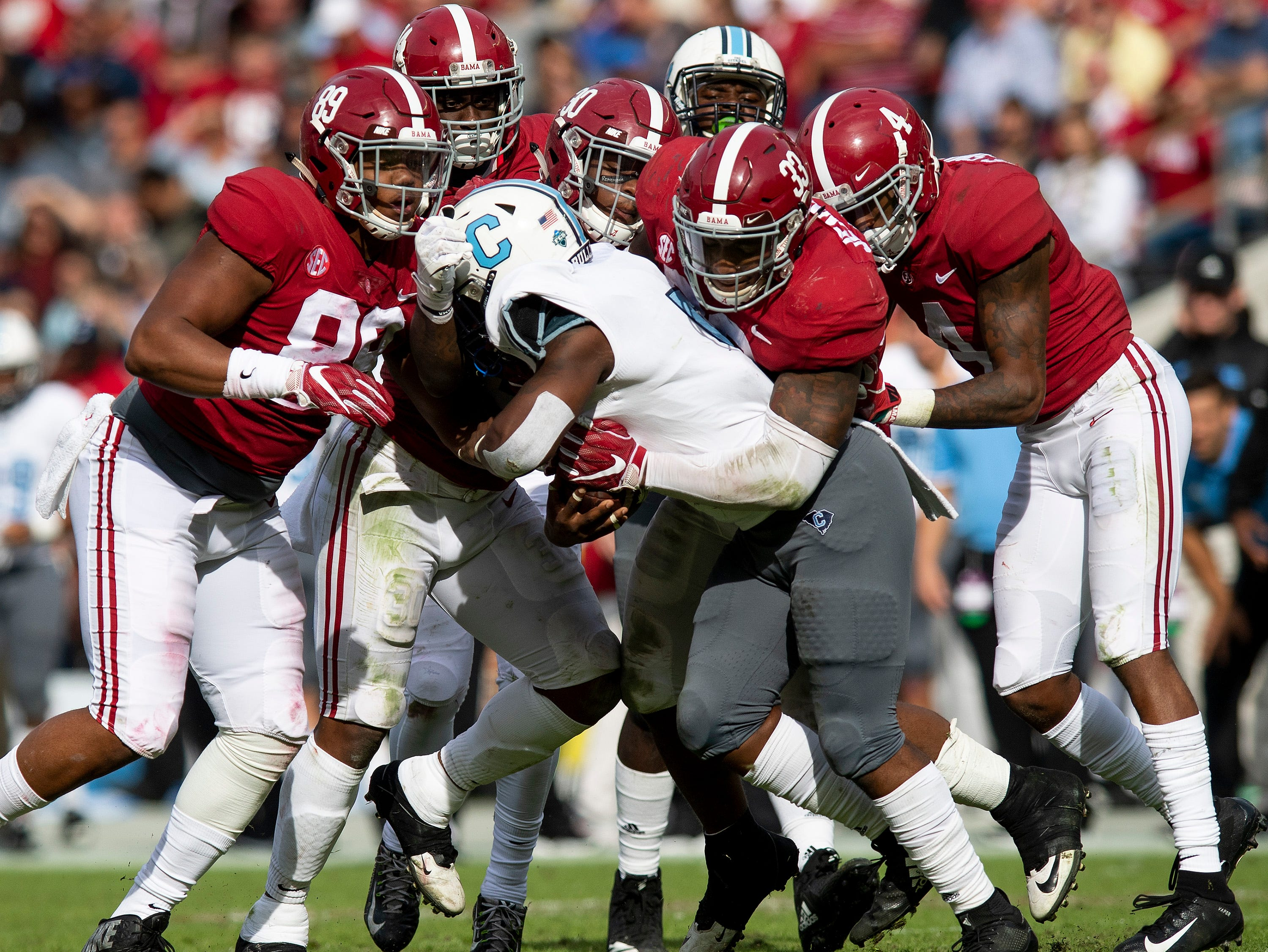 Citadel B-Back Clay Harris (5) is swarmed under by Alabama defensive lineman LaBryan Ray (89), linebacker Anfernee Jennings (33), defensive back Saivion Smith (4), linebacker Mack Wilson (30) and defensive back Deionte Thompson (14) in second half action at Bryant-Denny Stadium in Tuscaloosa, Ala., on Saturday November 17, 2018.
