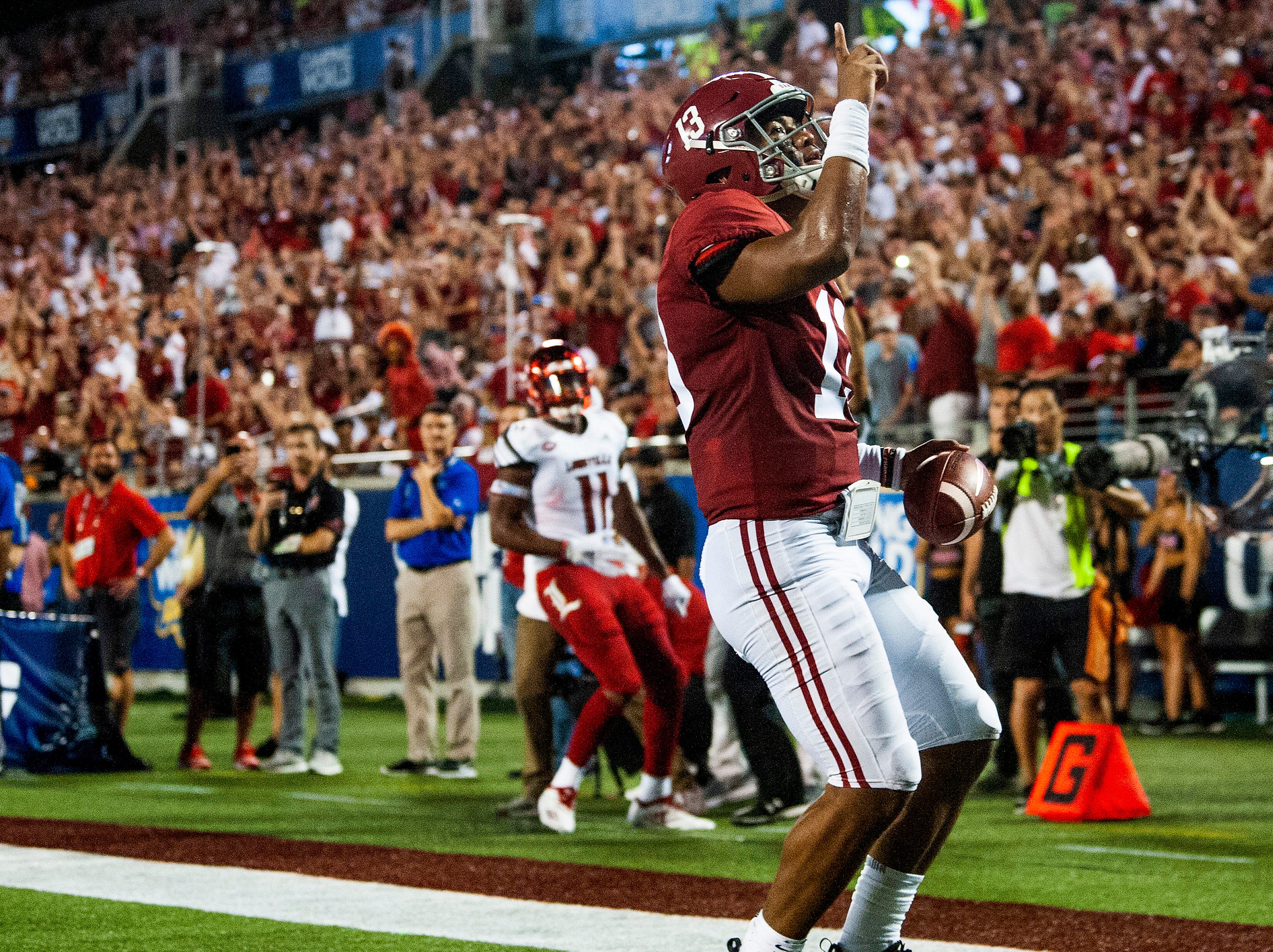 Alabama quarterback Tua Tagovailoa (13) after scoring a touchdown against Louisville In first half action of the Camping World Kickoff at Camping World Stadium in Orlando, Fla., on Saturday September 1, 2018.