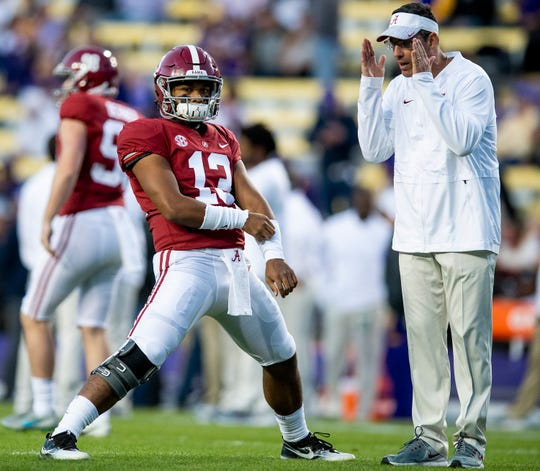 Alabama quarterback Tua Tagovailoa (13) stretches before the LSU game at Tiger Stadium in Baton Rouge, La., in 2018