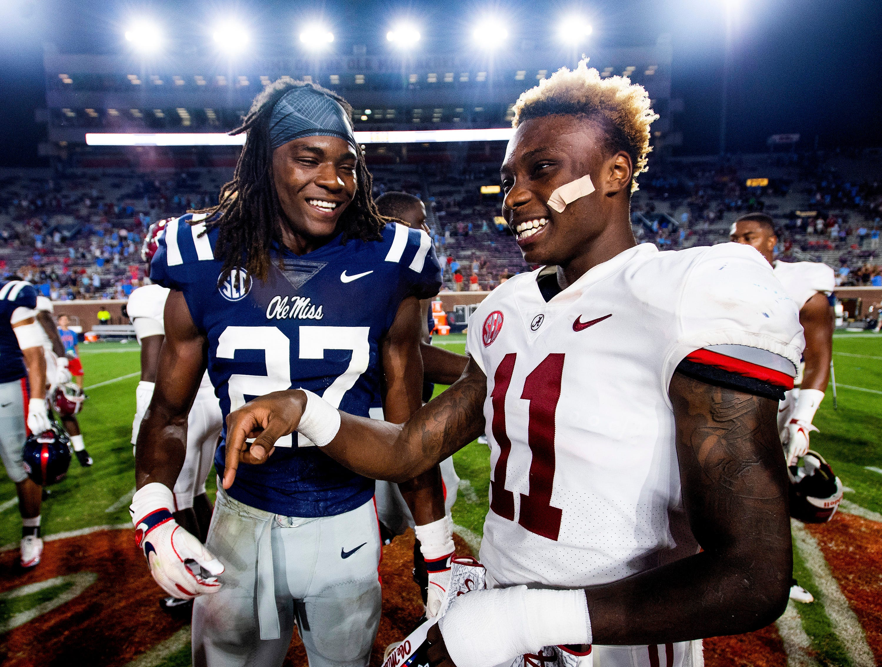 Brothers, Ole Miss linebacker Kevontae' Ruggs (27)  and Alabama wide receiver Henry Ruggs, III, (11), chat after their game in Oxford, Ms., on Saturday September 15, 2018.