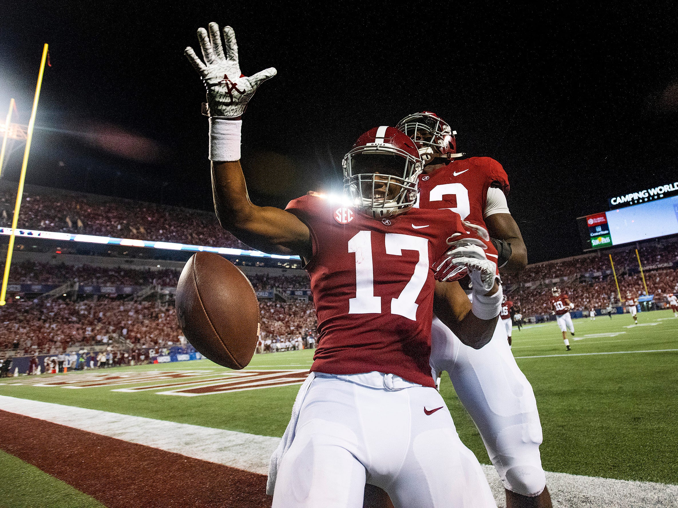 Alabama wide receiver Jaylen Waddle (17) celebrates a touchdown that is called back because of an Alabama penalty against Louisville in second half action of the Camping World Kickoff at Camping World Stadium in Orlando, Fla., on Saturday September 1, 2018.