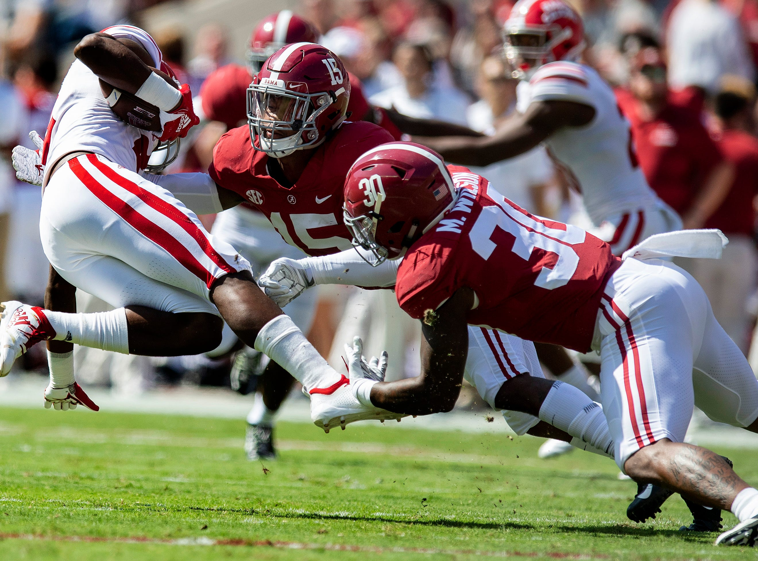 Alabama linebacker Mack Wilson (30) and defensive back Xavier McKinney (15) tackle Louisiana wide receiver Ja'Marcus (2) In first half action at Bryant-Denny Stadium in Tuscaloosa, Ala., on Saturday September 29, 2018.