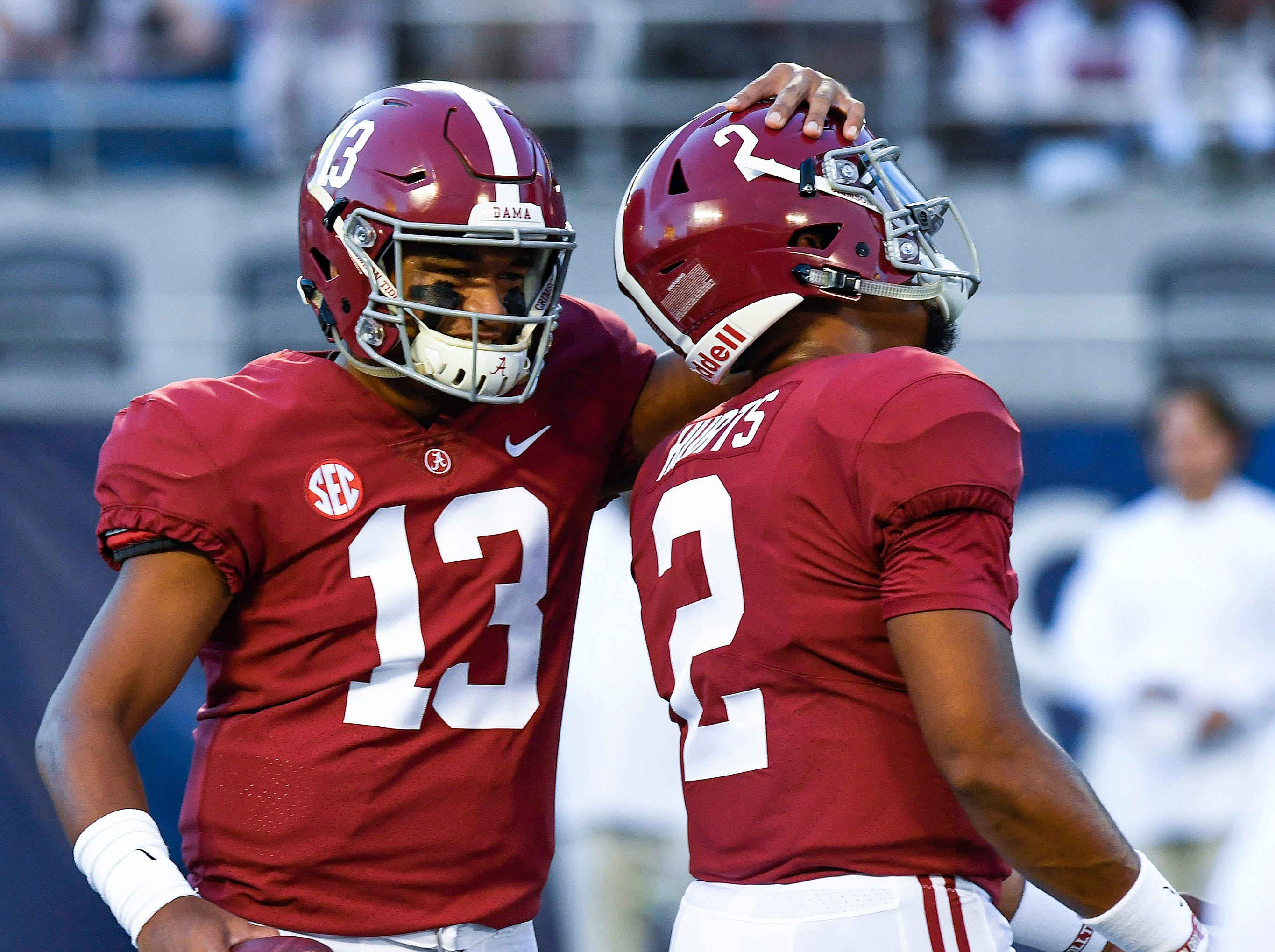 Alabama quarterback Tua Tagovailoa (13) hugs Jalen Hurts (2) during warmups before the Camping World Kickoff at Camping World Stadium in Orlando, Fla., on Saturday September 1, 2018.