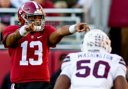 Alabama quarterback Tua Tagovailoa (13) directs the offense against Mississippi State in first half action at Bryant Denny Stadium in Tuscaloosa, Ala., on Saturday November 9, 2018.