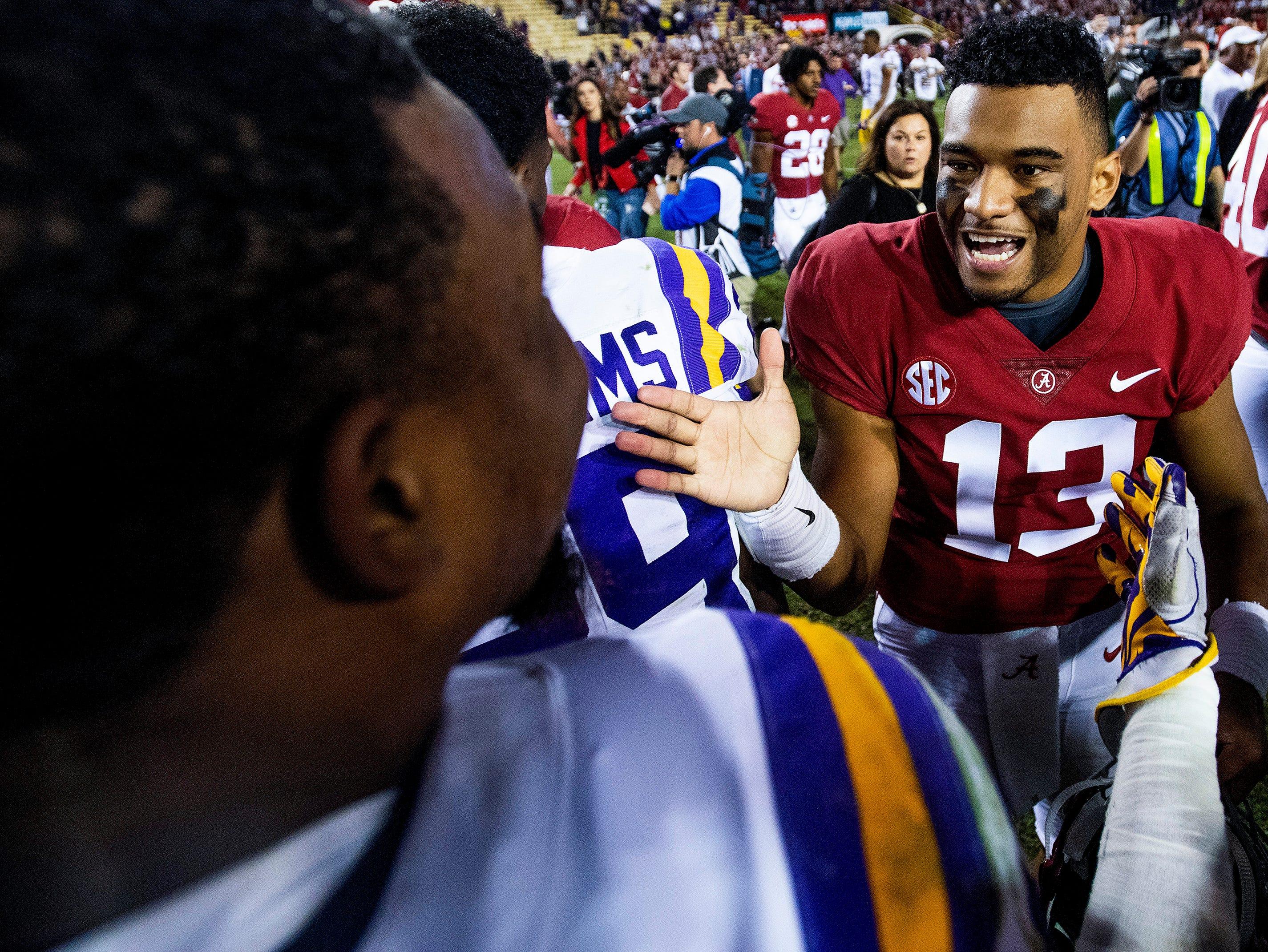 Alabama quarterback Tua Tagovailoa (13) greets Louisiana State University outside linebacker Michael Divinity, Jr., (45) after defeating LSU at Tiger Stadium in Baton Rouge, La., on Saturday November 3, 2018.